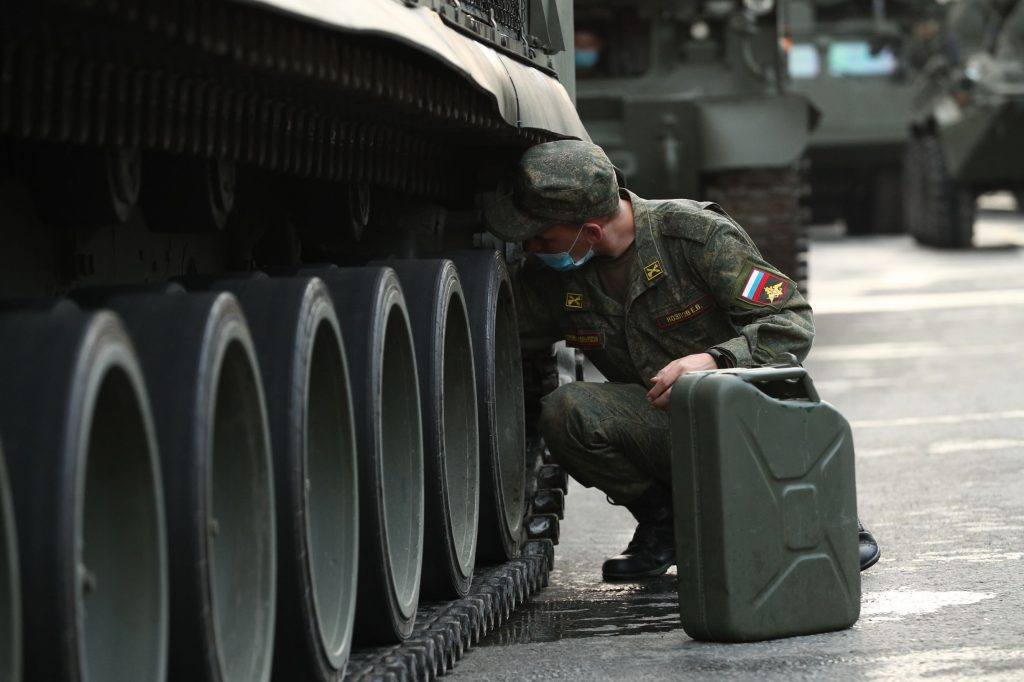 A Russian soldier refills a missile launcher via a 'jerry can' gas can