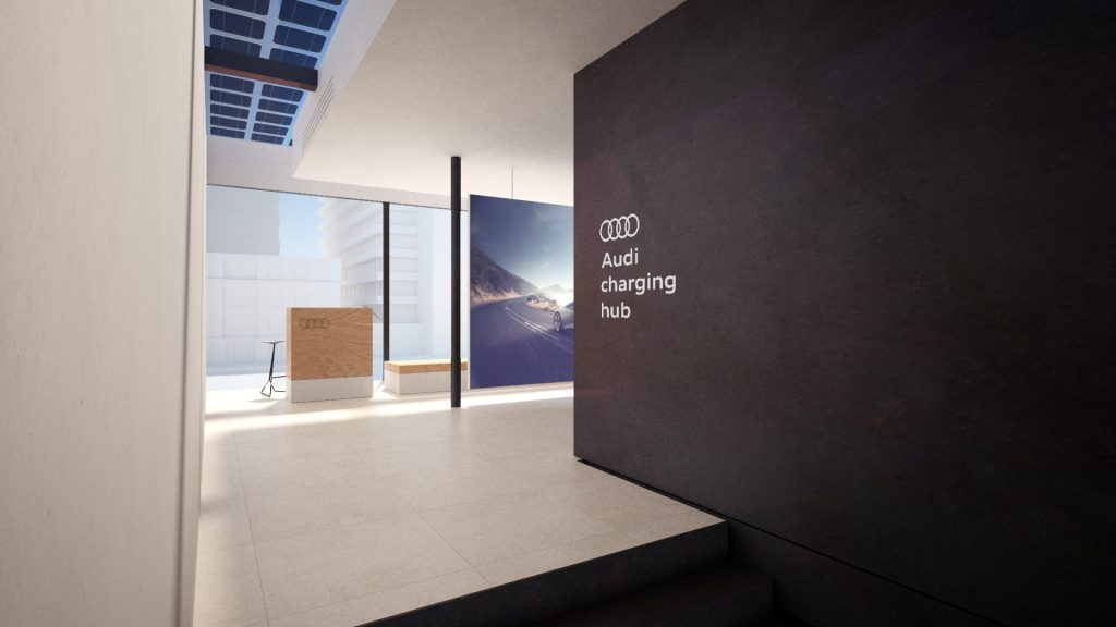The interior of Audi's new charging hub concept with wood, tile and black walls