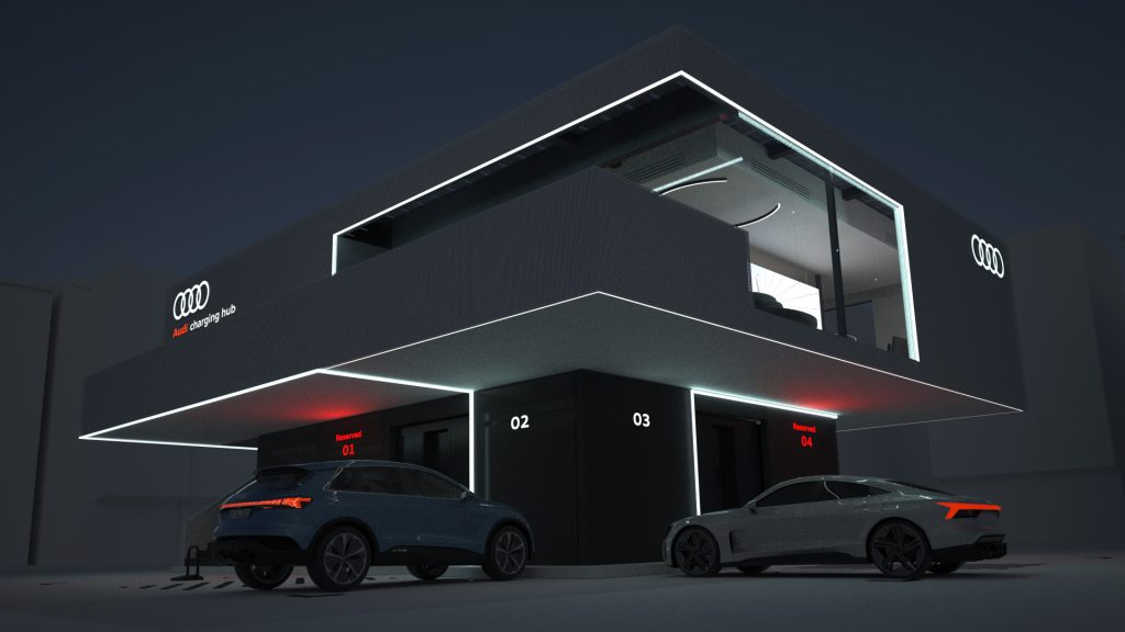 An exterior shot of the German brand's charging hub at night, computer rendered with a few e-tron models parked out front