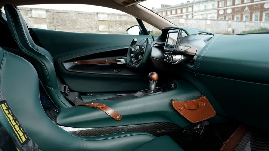 The green and carbon fiber interior of the Victor, with a stick shift gear knob rising out of the center console