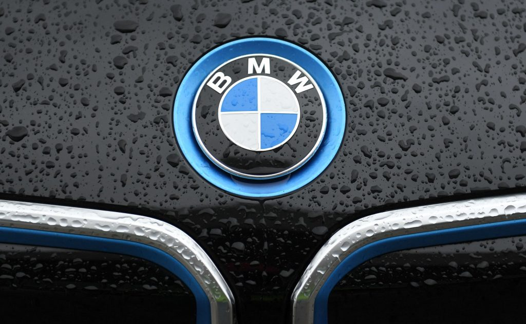 A BMW logo on the hood of a black car on March 15, 2021, in Munich, Germany