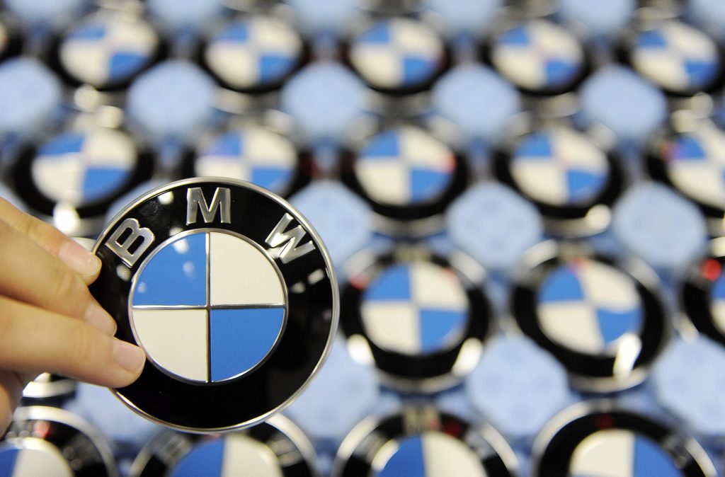 BMW logo badges in the manufacturing facility