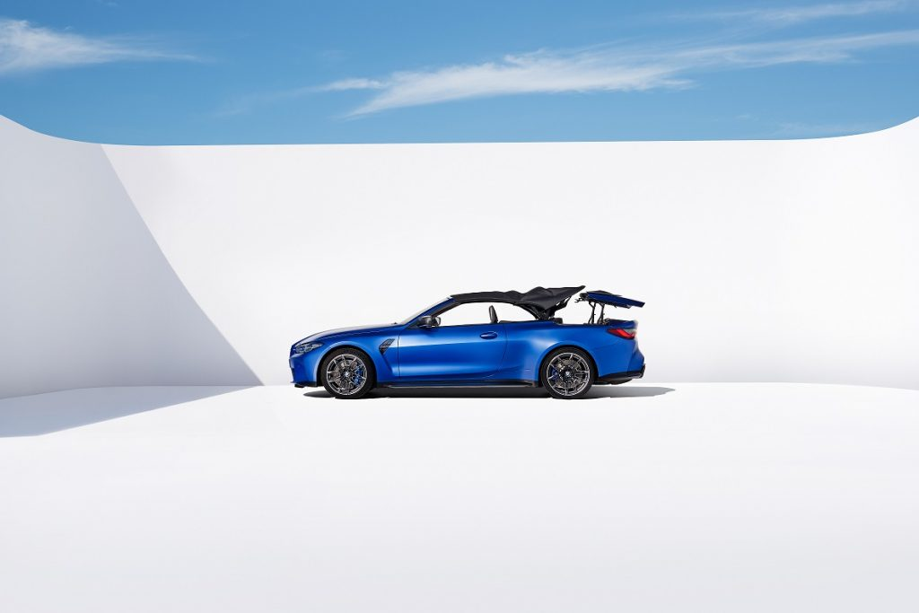 The BMW M4 in the process of putting the top down