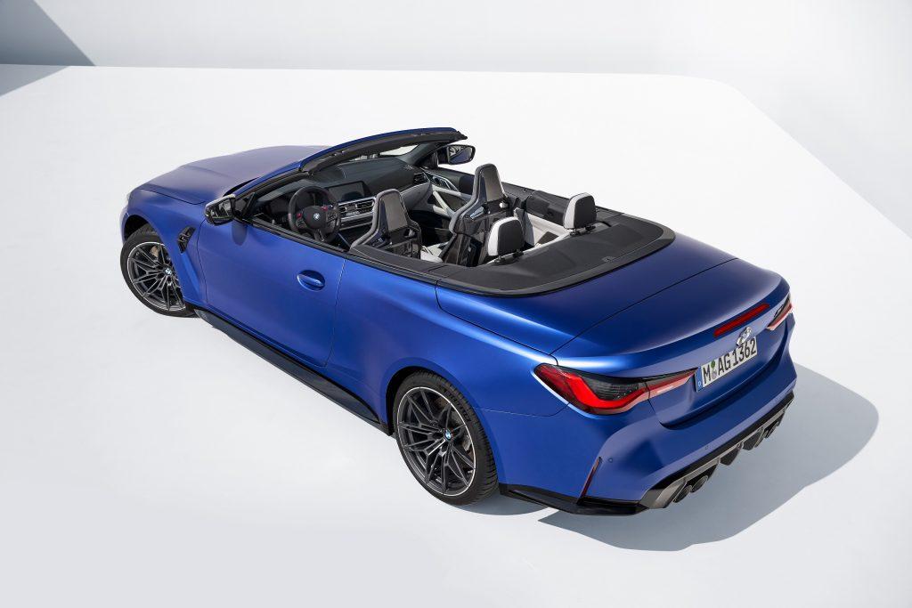 A high rear 3/4 shot of a blue 2022 BMW M4 convertible