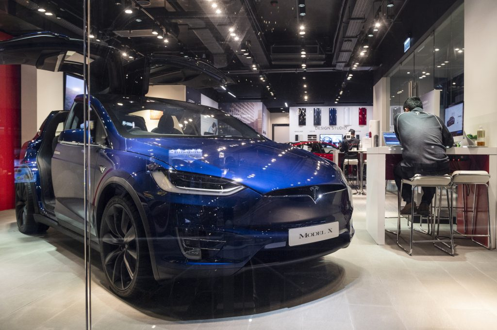 American electric company car Tesla Motors official authorized car dealer store as it displays the blue Model X