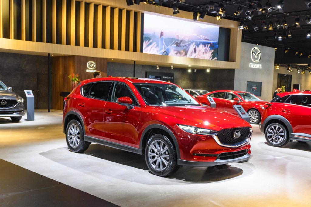 A red Mazda CX-5 SUV on display