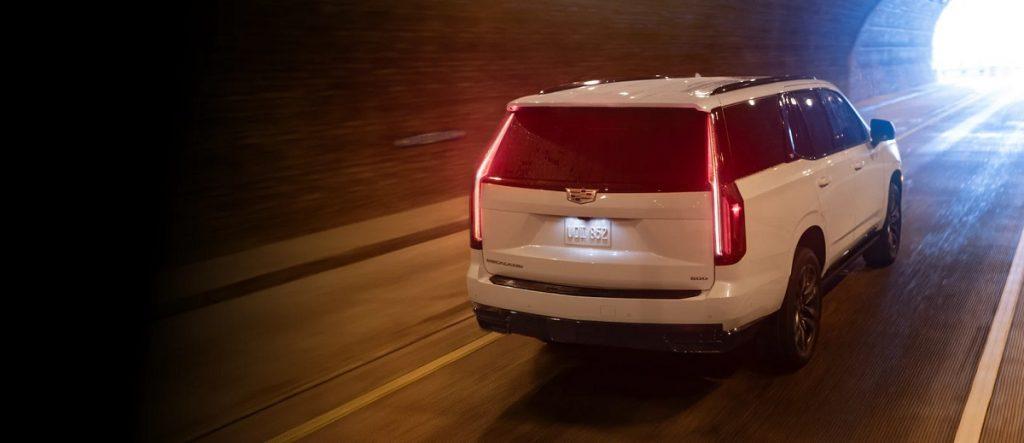A 2021 Cadillac Escalade drives through a tunnel.
