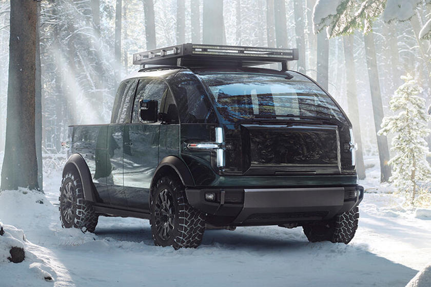 The 2023 Canoo pickup in the forrest