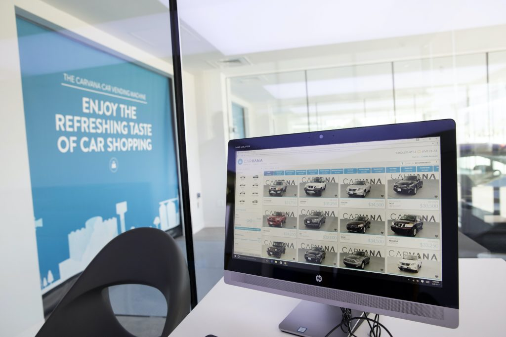 A computer monitor displayed available vehicles inside the Carvana Co. car vending machine.