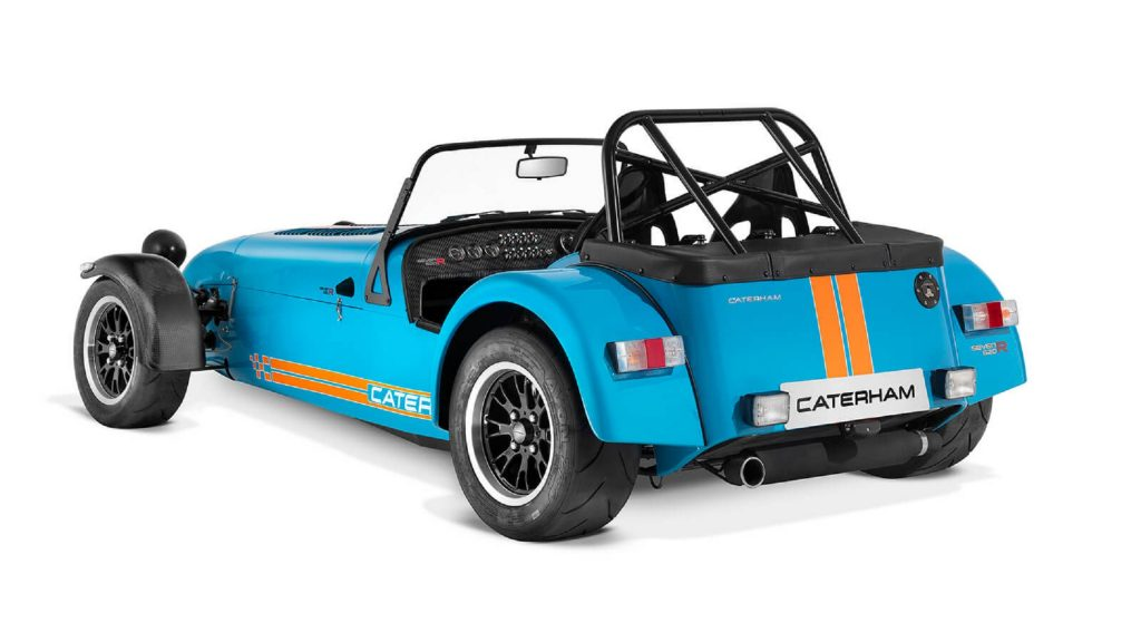 The rear 3/4 view of a blue-and-orange Caterham Seven 620R