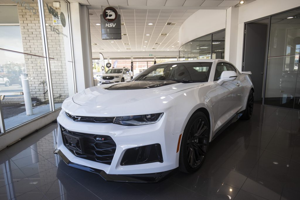 A white Chevrolet Camaro vehicle is seen at a Holden dealership on January 4, 2021