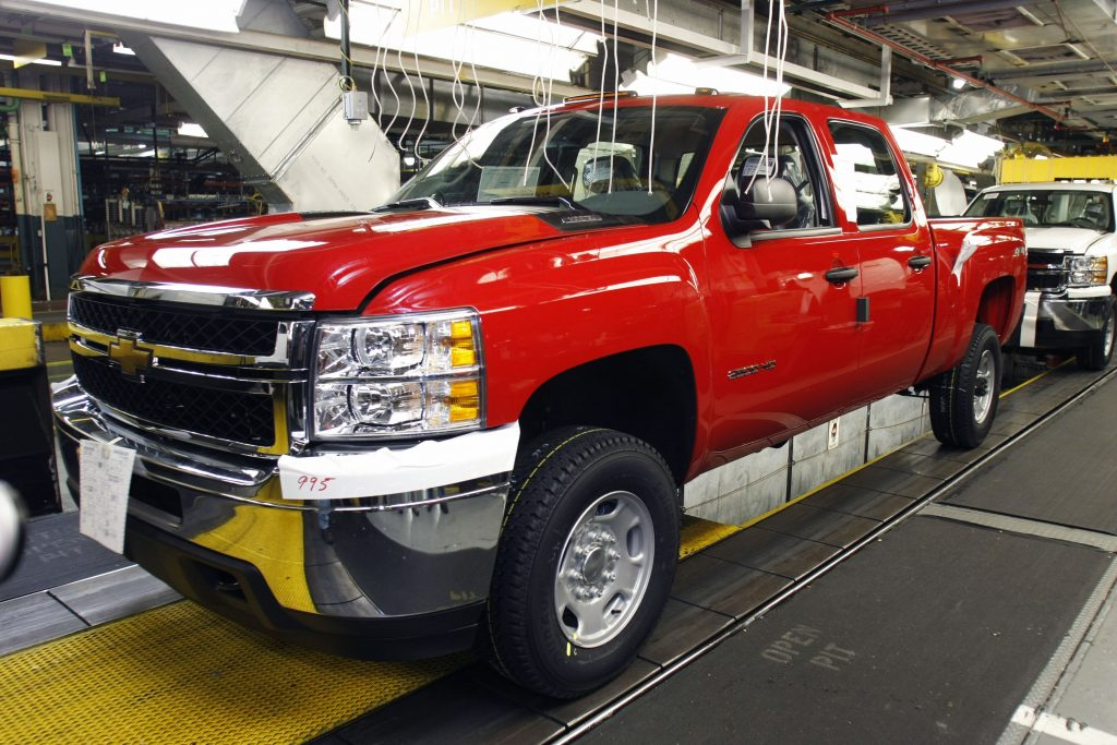 A Chevy Silverado Coupe Cab HD truck is built on the assembly line of the General Motors Flint Assembly Plant January 24, 2011