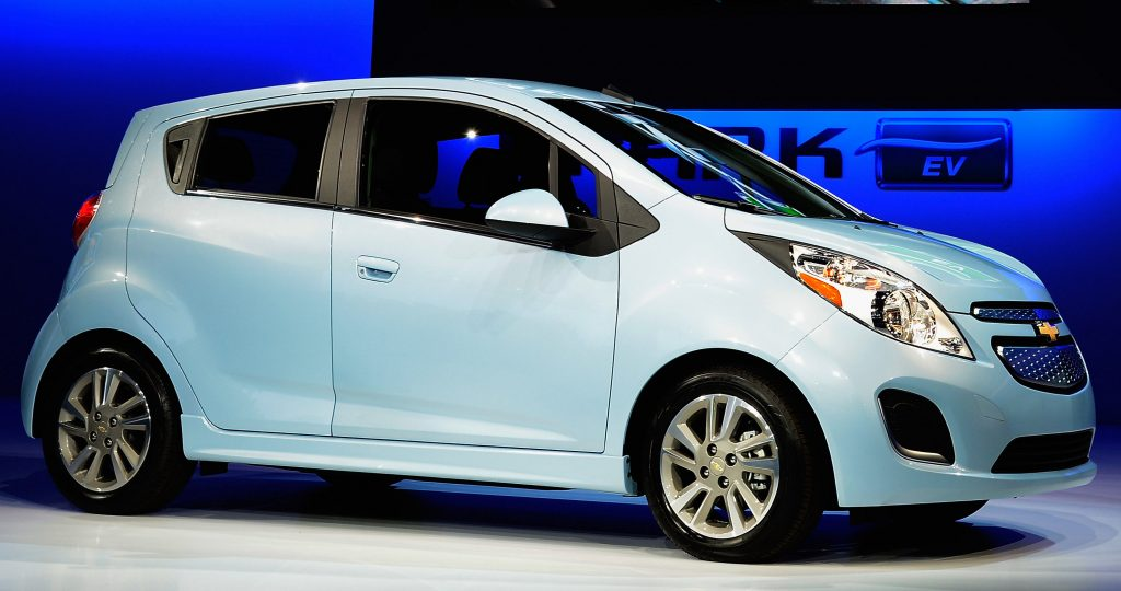 A Chevy Spark is under a blue spotlight on display in 2012.