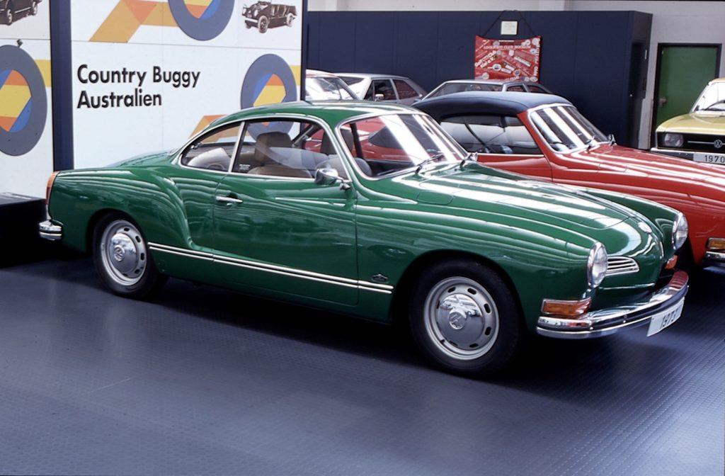 An emerald green classic 1973 Karmann Ghia coup on display