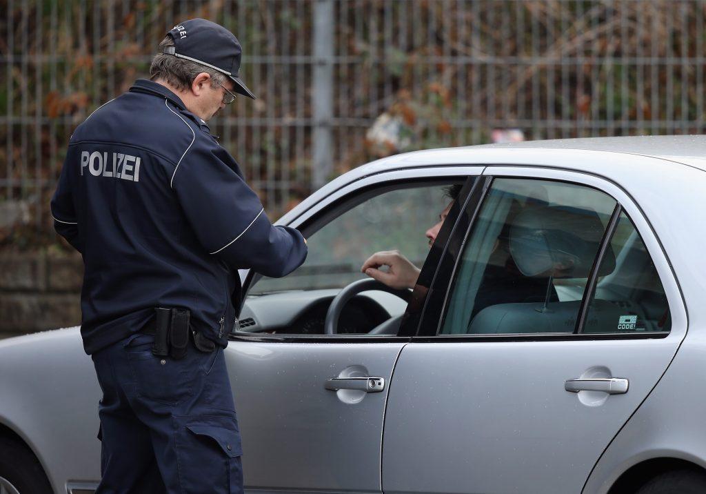 A policeman pulls over a car.