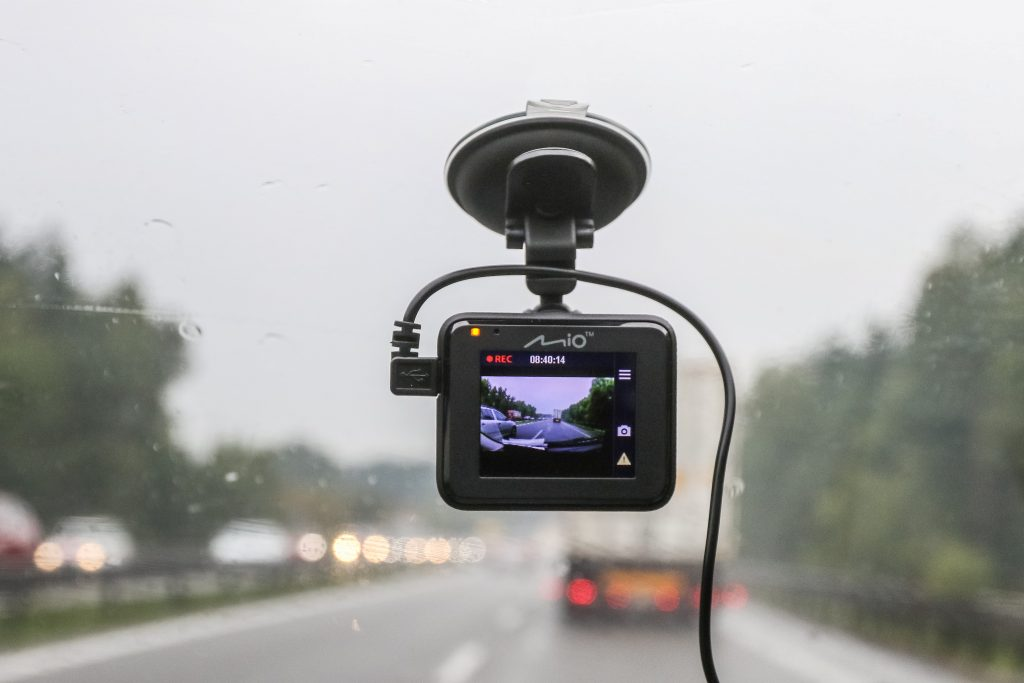 Mio dash cam mounted in car is seen in Gdansk, Poland on 14 August 2018 Sales of car cameras (dash cams) is growing in Poland
