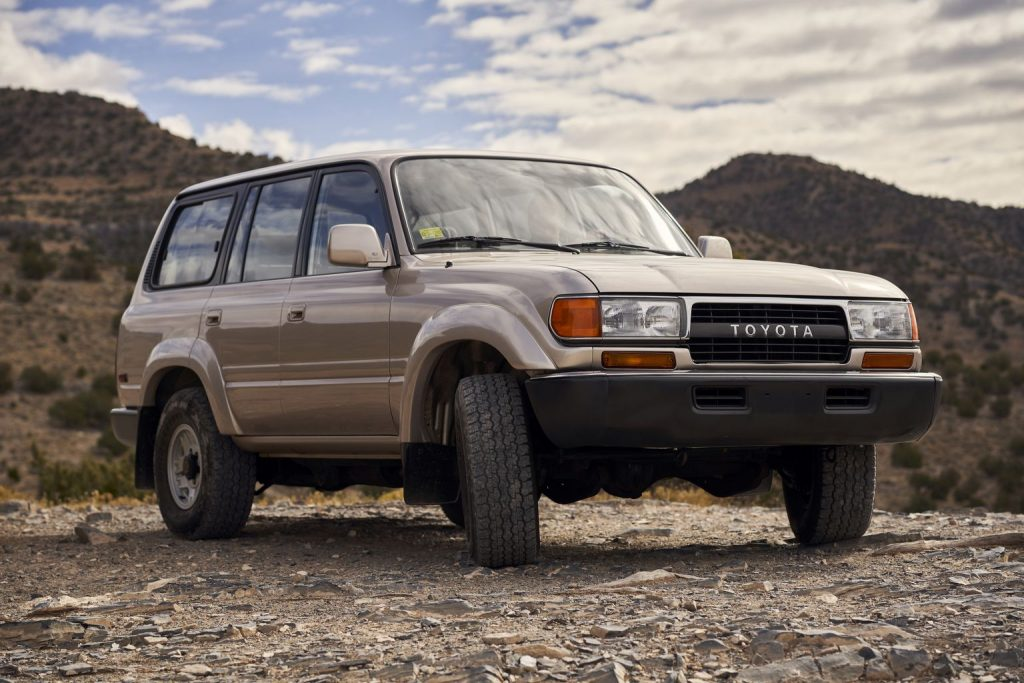 a 1991 Toyota Land Cruiser 80 series parked off-road in the mountains