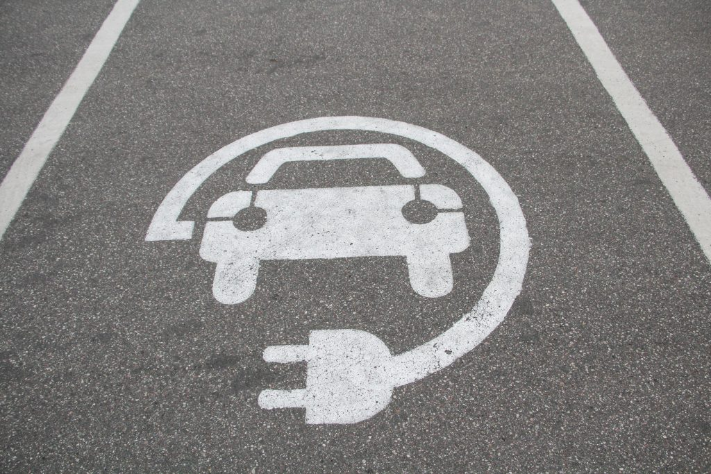 An electric vehicle charging station parking space