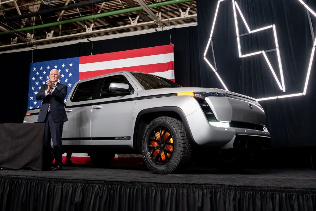 Endurance EV pickup with Pence standing by
