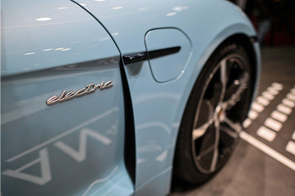 A light blue Porsche Taycan 4S electric vehicle