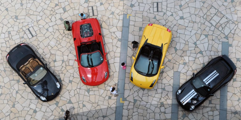 Lamborghini and Ferrari cars in a row