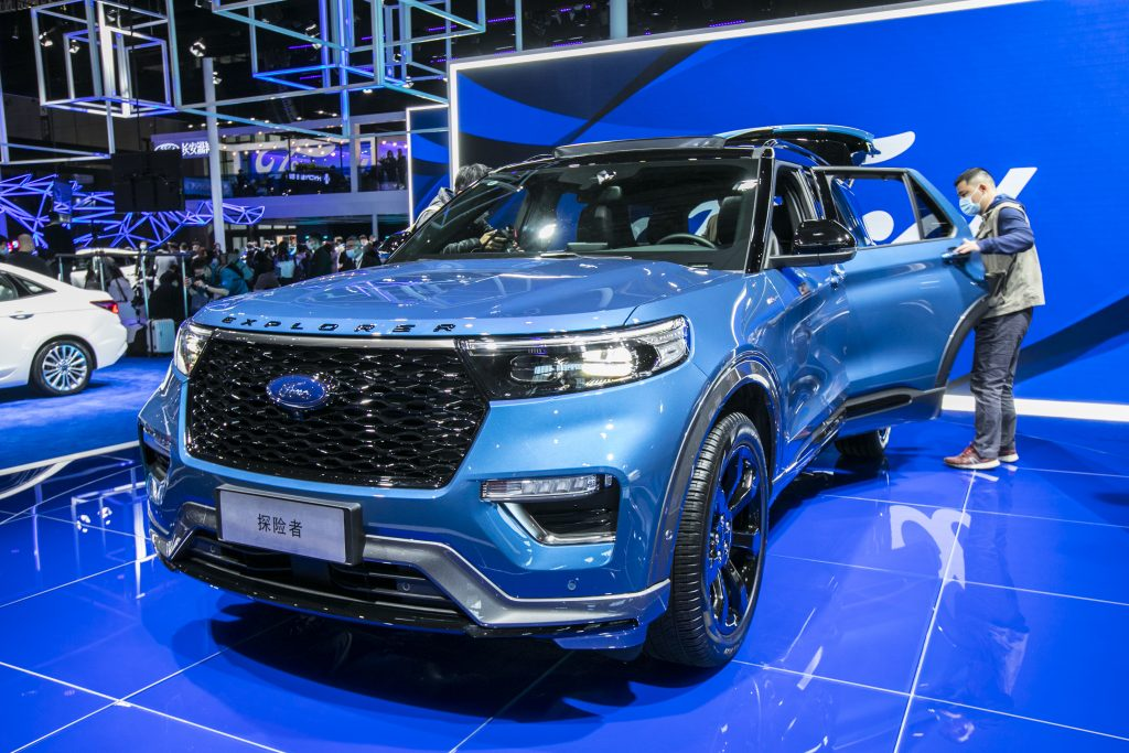 A blue 2021 Ford Explorer at a car show. The Explorer joins Ford's EV lineup including the Ford Mustang Mach-E, E-Transit and F-150 Lightning.