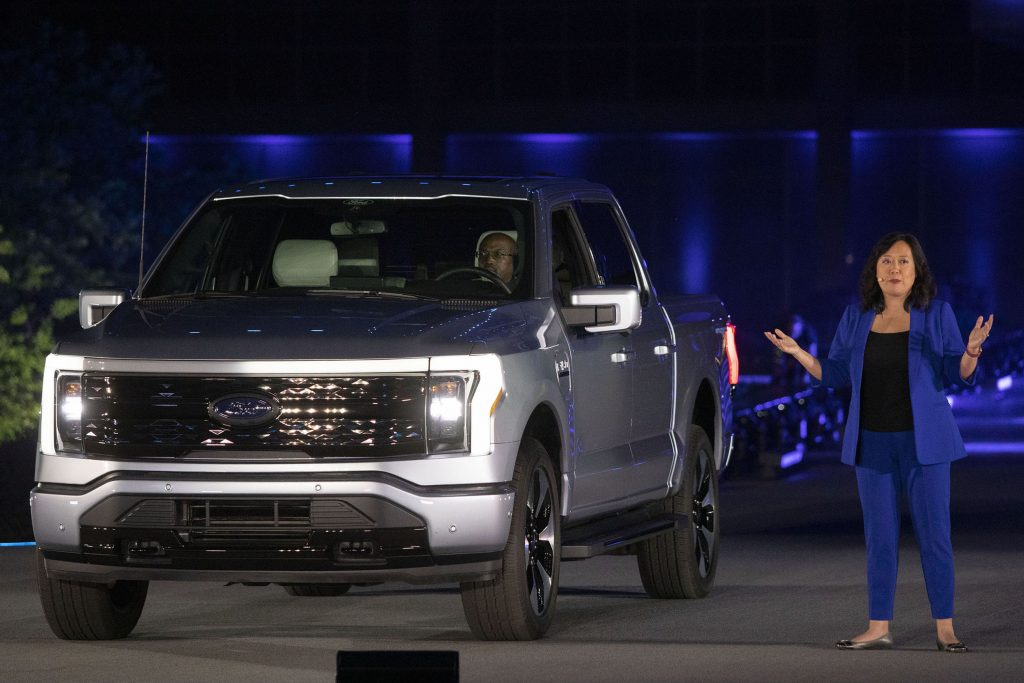 Linda Zhang, Chief Engineer, speaks at the reveal of the new all-electric Ford F-150 Lightning pickup truck in silver at Ford World Headquarters
