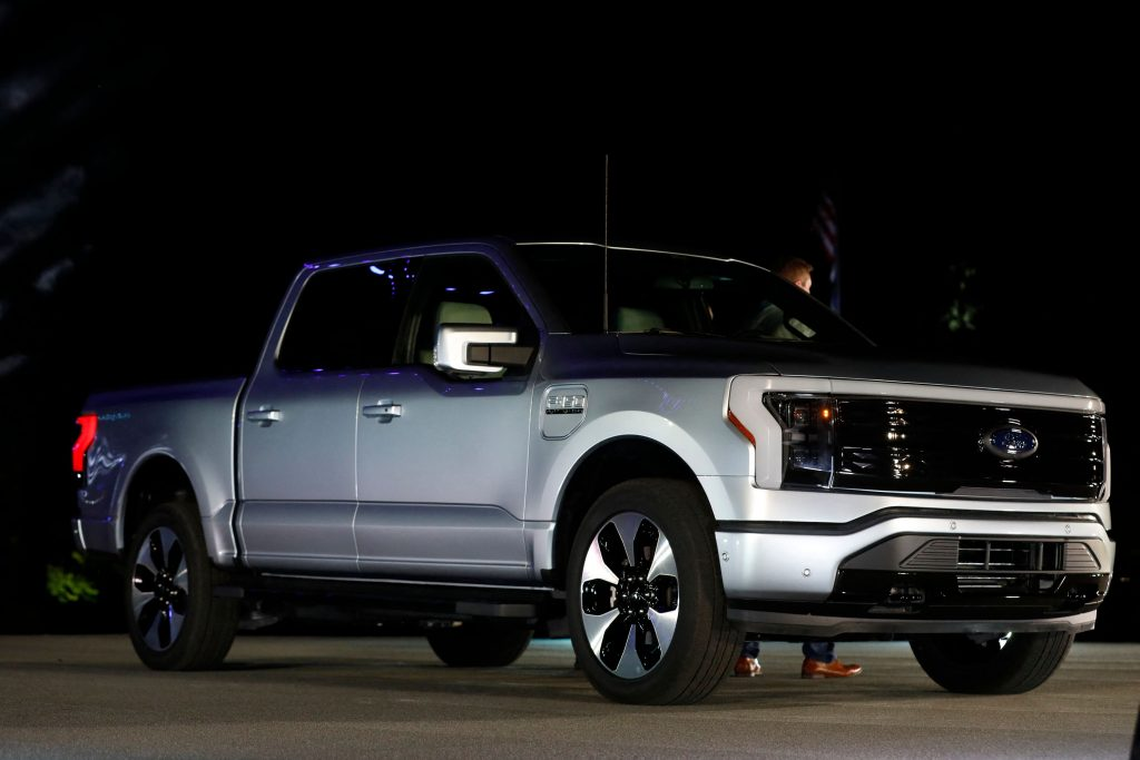 A Ford F-150 Lightning outside at night. Ford electric vehicles will be getting batteries from BlueOvalSK.