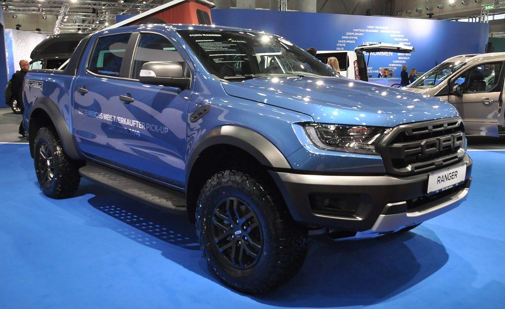 A blue Ford Ranger at a car show.