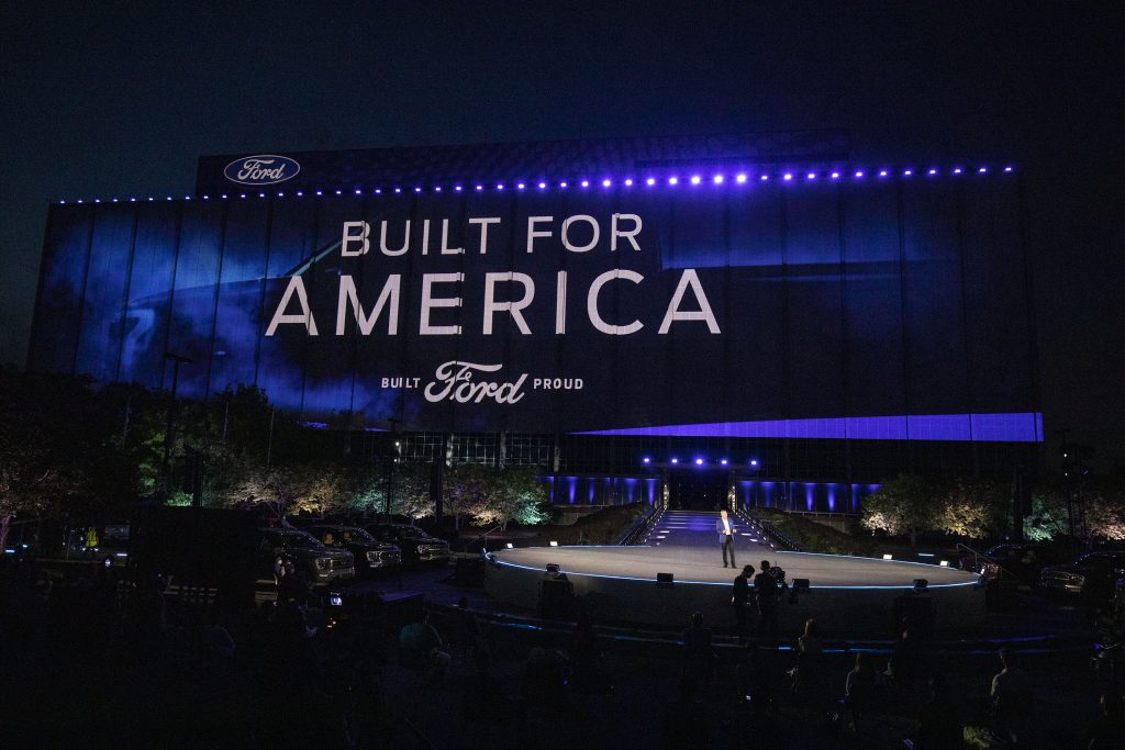 The Ford logo on stage at Ford World Headquarters as Ford announces new electric vehicle lineup.