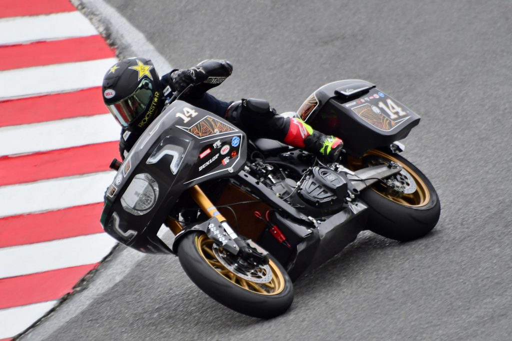 Frankie Garcia takes a corner on the black-and-gold 2021 RSD King of the Baggers Indian Challenger