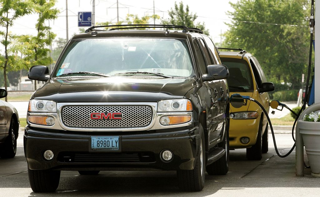 A GMC Yukon fuels up. Larger SUVs are safer, but not as fuel-friendly.