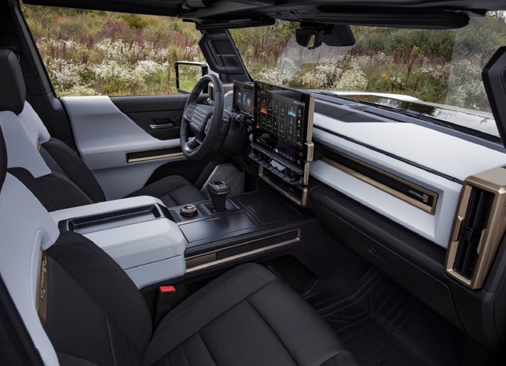 The white-and-black-leather front seats and dashboard of a GMC Hummer EV Truck Edition 1