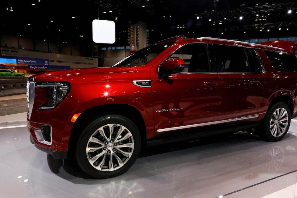 A 2021 GMC Yukon at a car show. The Yukon is one of the largest SUVs you can buy, but is it as safe as the Ford Expedition?