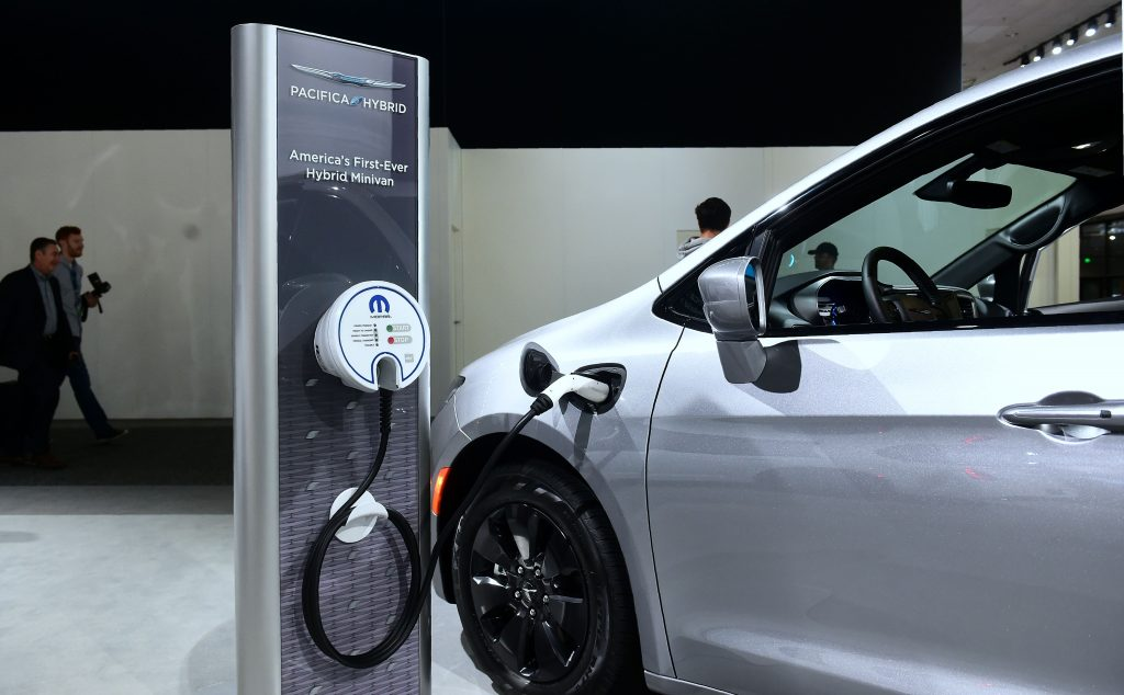 charging the Chrysler Pacifica Hybrid at a public charging station.