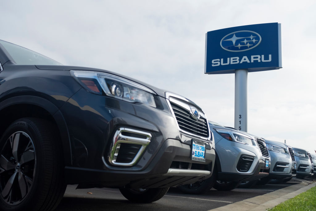 subaru models on a dealership lot with the logo on a sign. your model could be affect by the recall.