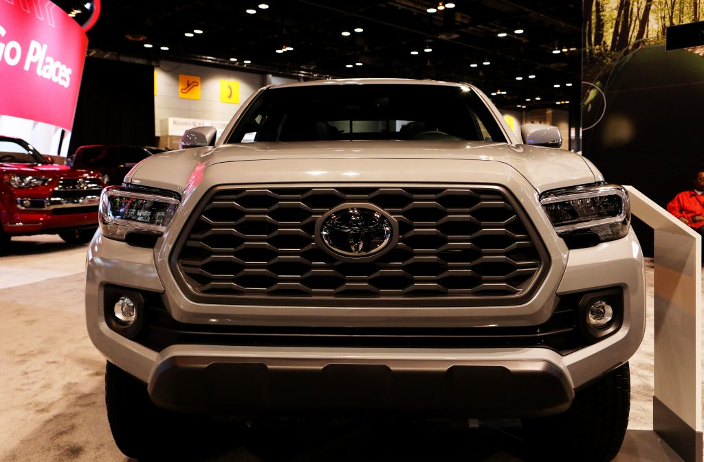 A 4x4 Toyota Tacoma on display at an auto show.