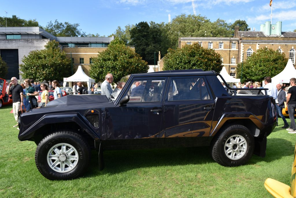 A 1990 Lamborghini LM002 4X4 parked on a lawn in black