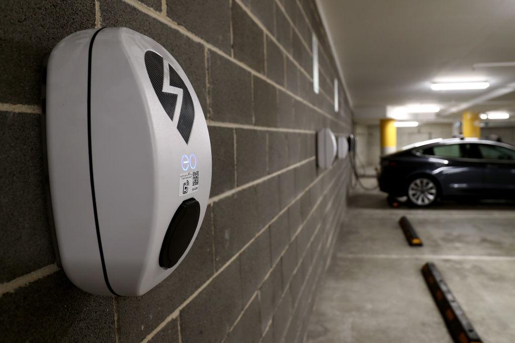 A grey Model Y charging in an underground parking garage