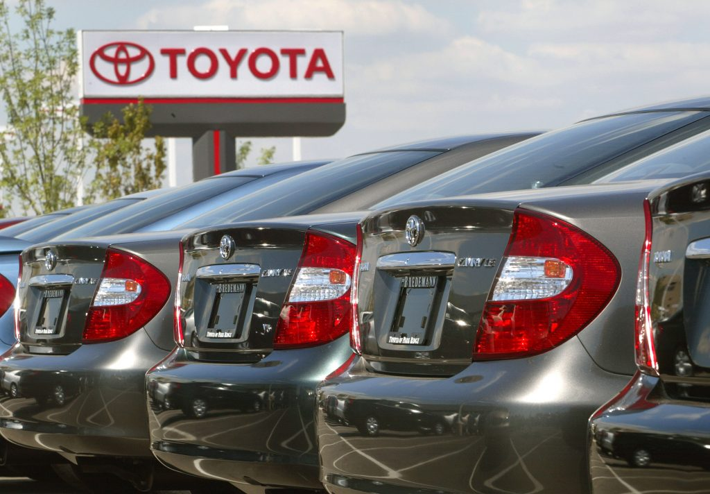 a row of 2002 Toyota Camry models at a dealership