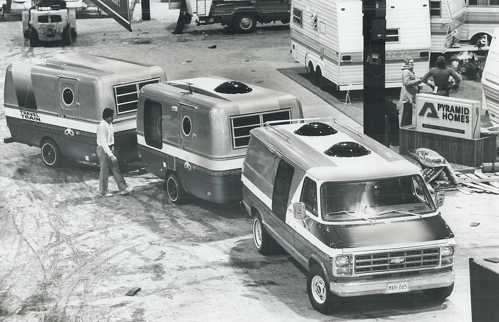 RV triple towing in an old black and white photo