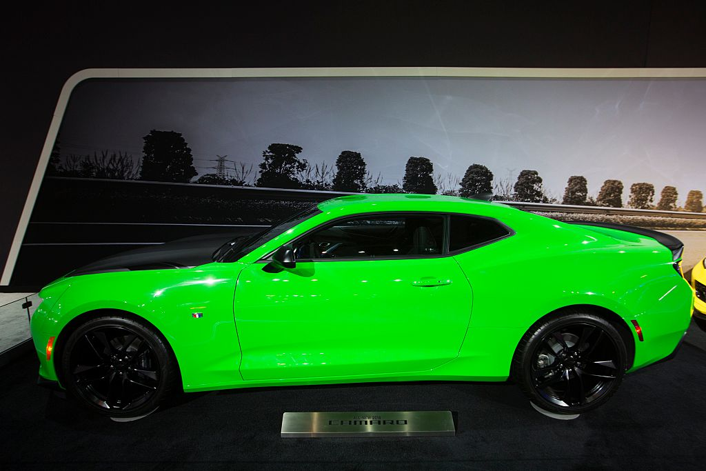 a green Chevrolet Camaro on display exemplifies a car with some of the best resale value around