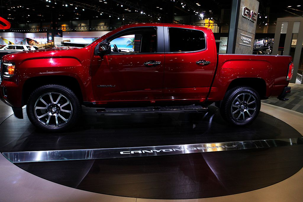 a red GMC Canyon at an auto show on display