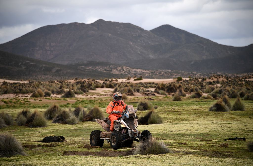 A professional riding a quad made by the Yamaha ATV brand off-road in the Dakar Rally.