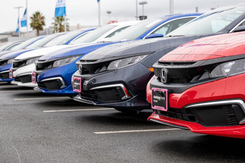 A lineup of Honda models parked at a dealership