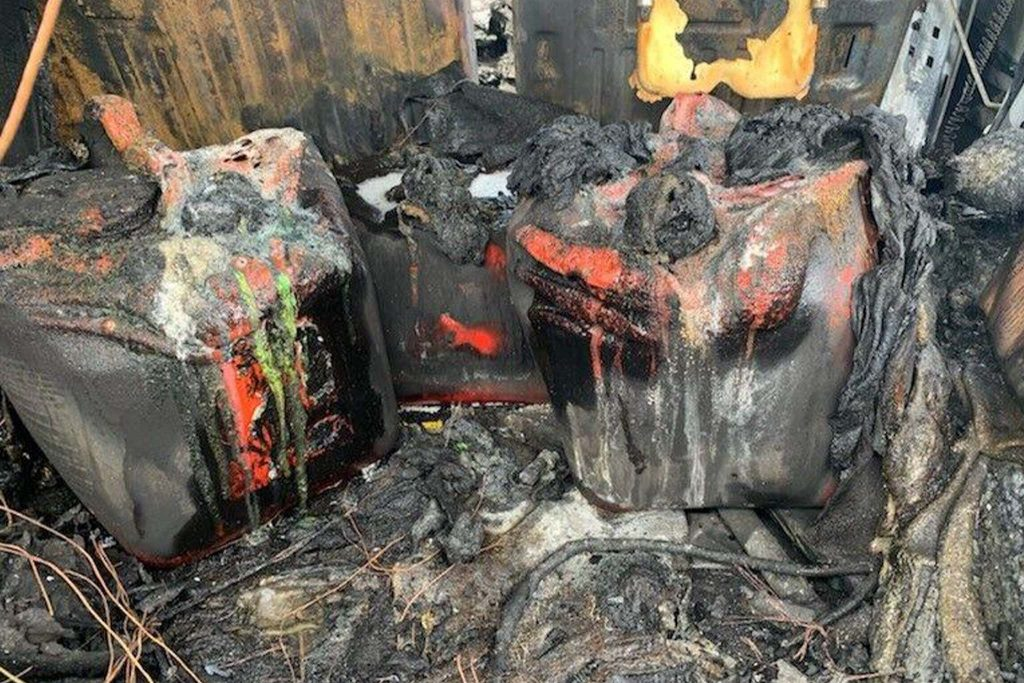 melted gas cans in the back of the Hummer H2