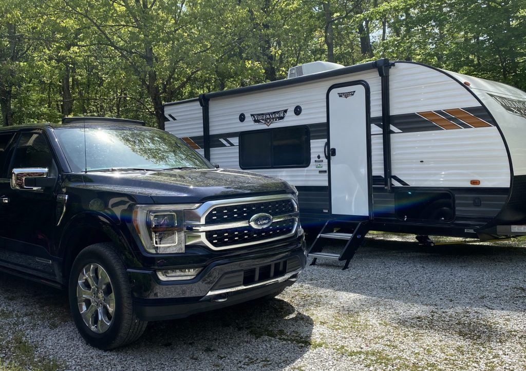 The Ford F-150 PowerBoost with a WildWood Camper