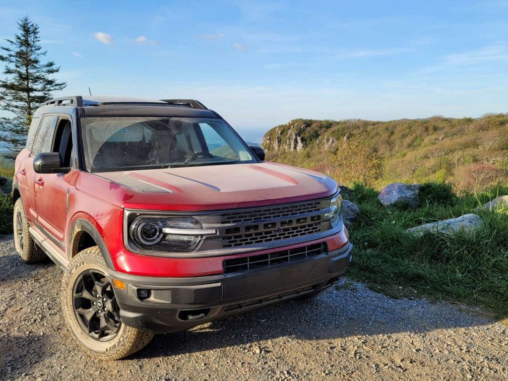 A red 2021 Ford Bronco Sport parked in front of a mountain view