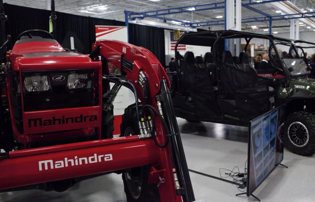 a red Mahindra tractor model on display