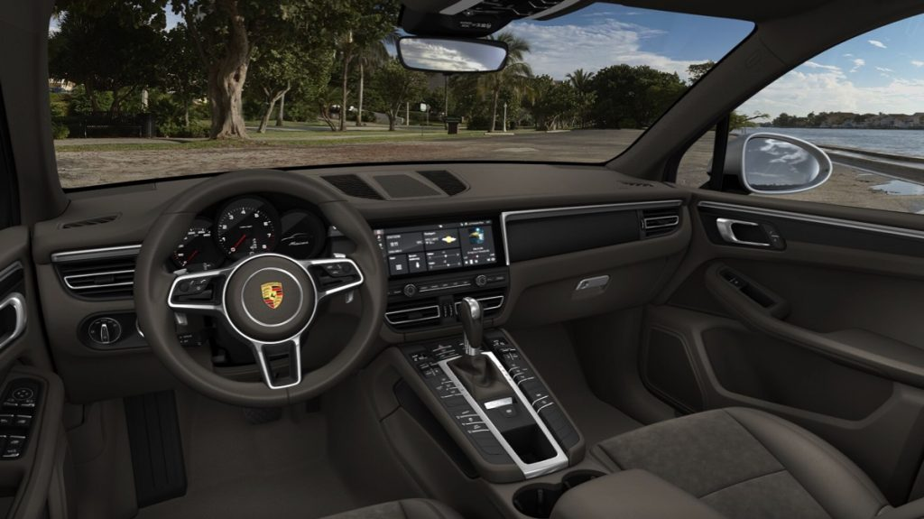 The interior of the 2021 Porsche Macan with grey seats.